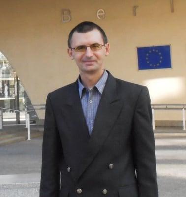 Али Шуган