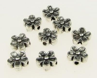 Мънисто метал цвете 7x3.5 мм дупка 1 мм цвят сребро -20 броя