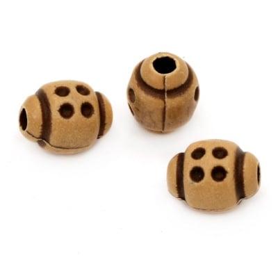 Мънисто Антик 12x10 мм дупка 3-4 мм кафяво -50 грама ~ 75 броя