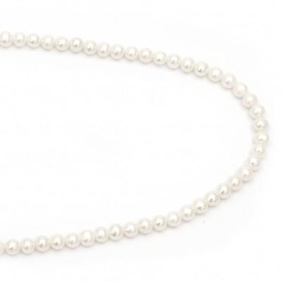 Наниз мъниста естествена перла 6 мм дупка 0.5 мм клас ААА цвят крем ~64 броя