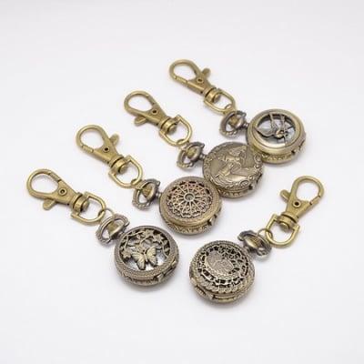 Ключодържател часовник отварящ метал цвят античен бронз 80 мм. АСОРТЕ